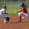 Webb City's Fallon Holcomb gets the throw to tag out Seneca's Gracie Heckart during Saturday's Paige Neal/Christina Freeman Softball Tournament at the Joplin Athletic Complex.<br /> Globe | Roger Nomer