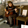 Musician Caleb Miller entertains visitors at Urban Art on Thursday during the First Thursday ArtWalk in downtown Joplin.<br /> Globe | Laurie Sisk