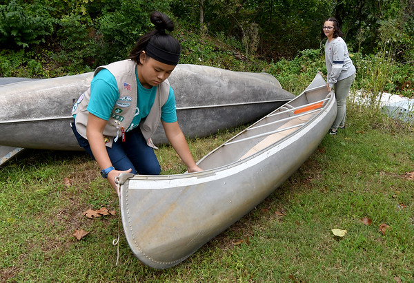 From the left: Girl Scouts Megan Walser, 13 and Yasmina Mokhtar, 13 organize canoes on Wednesday at Camp Mintahama.<br /> Globe | Laurie Sisk