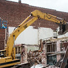 Demolition continues on the Howsmon building on Friday afternoon.<br /> Globe | Roger Nomer