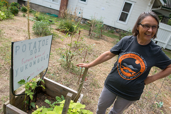 Rebecca Jim, executive director of the LEAD Agency, talks about the agency's community garden on Monday in Miami.<br /> Globe | Roger Nomer