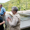Sara Parker Pauley, director of the Missouri Department of Conservation, left, talks with Carmen Rogers, concessionary at Roaring River, before Friday's groundbreaking at the hatchery.<br /> Globe   Roger Nomer