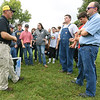 Missouri Extension agent Tim Schnakenberg, left, chats with Lamar FFA students and advisor Jim Weber, right,  about Big Bluestem grass as an alternative to K31 on Thursday at the University of Missouri Southwest Research Center near Mount Vernon. <br /> Globe | Laurie Sisk