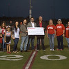 Local State Farm Insurance agents present a check for $25,000 to the Power of Play Project as a grant award from State Farm Neighborhood Assist program on Friday during the home Carl Junction High School football game. The Power of Play Project is raising funds to renovate school playgrounds so that they are accessible for all children, regardless of physical capabilities.<br /> Globe | Roger Nomer