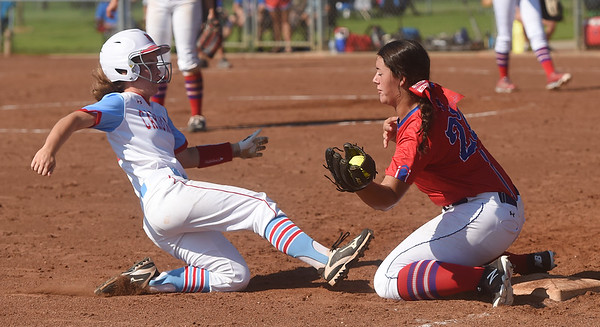 Webb City's Ali Vanzant slides safely into third past Seneca's Mekaylee Beard during Saturday's Paige Neal/Christina Freeman Softball Tournament at the Joplin Athletic Complex.<br /> Globe | Roger Nomer