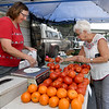 From the left: Tammy Wilson, of Wilson Farms Greenhouse and Produce in Jerico, assists Carthage Farmers Market regular customer Carolyn Cole as she selects fresh tomatoes on Wednesday on the Carthage Square.<br /> Globe | Laurie SIsk