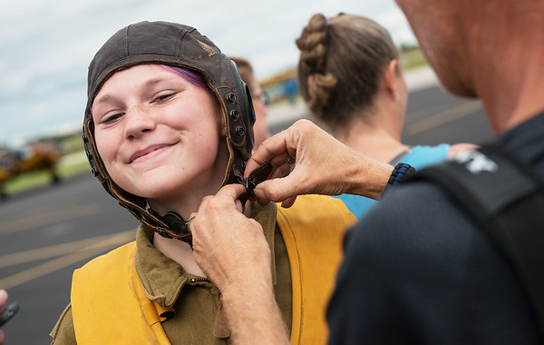 "Ella Denno, 13, Granby, prepares to tour the B-29 Bomber ""Fifi"" on Monday at the Joplin Regional Airport. Denno wore the WWII uniform of a Women Airforce Service Pilot for the visit.<br /> Globe 