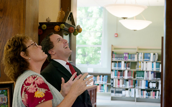 Julie Yockey, Carthage Public Library director, proudly shows Missouri Secretary of State Jay Ashcroft the dome at the library during a tour on Tuesday.<br /> Globe | Roger Nomer
