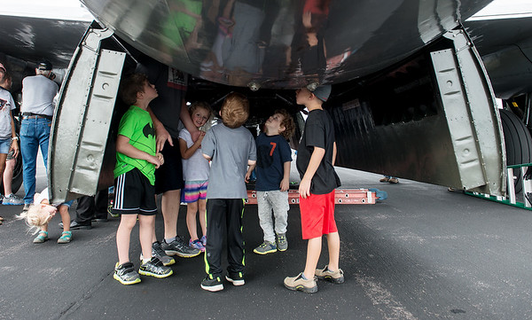 """Visitors take a closer look at the interior of the B-29 Bomber """"Fifi"""" on Monday at the Joplin Regional Airport.<br /> Globe 