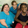 Triathlete Vanessa Workman, right, shares a laugh with her mother, Leatta Workman, left and personal assistant Angela Covington, center, after therapy on Friday at the Neosho Freeman Family YMCA. Workman is training to compete Sunday in St. Louis at the Tri My Best Adaptive Triathlon.<br /> Globe | Laurie SIsk