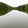The treeline is reflected off the glasslike surface of Lake Mintahama on Wednesday at the camp.<br /> Globe | Laurie Sisk