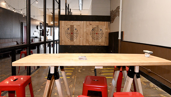 Enclosed lanes allow for safety at Main Street Axe Company - a place where throwers can test their skills or join a league.<br /> Globe | Laurie Sisk