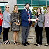 Joplin Elks Exalted Ruler Will Lynch, center, presents a $1,000 check to American Heart Association Developmental Director Kayla Moore on Thursday at Mercy Hospital. Joining the two are staff of the Mercy Cardiac Catherization Lab, who volunteered with other Elks during their monthly breakfast to raise the money.<br /> Globe | Laurie Sisk