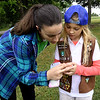 From the left: Girl Scout Shayla Gould, 12 looks at a painted rock left by a previous camper and later found by Brownie Scout Grace Carrier, 9 on Wednesday at Camp Mintahama.<br /> Globe | Laurie Sisk