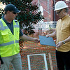 Tony Raleigh, historical roofing specialist with Renaissance Roofing, left, and Michael Englebert Griffin, preservation architect for the living museums project, talk about the roofing slate being used in the restoration on Wednesday.<br /> Globe | Roger Nomer