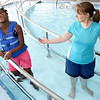 From the left: Triathlete Vanessa Workman smiles as she prepares to enter the pool with personal assistant Angela Covington on Friday at the Neosho Freeman Family YMCA. Workman is training to compete Sunday in St. Louis at the Tri My Best Adaptive Triathlon.<br /> Globe | Laurie SIsk