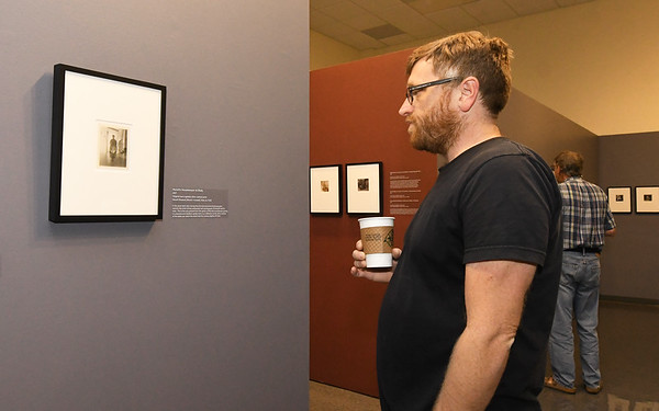 Missouri Southern painting professor Kyle McKenzie checks out the works of photographer Edvard Munch on Friday at Missouri Southern's Spiva Art Gallery during an opening reception for the Experimental Self: Edvard Munch's Photography.<br /> Globe   Laurie Sisk