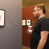 Missouri Southern painting professor Kyle McKenzie checks out the works of photographer Edvard Munch on Friday at Missouri Southern's Spiva Art Gallery during an opening reception for the Experimental Self: Edvard Munch's Photography.<br /> Globe | Laurie Sisk