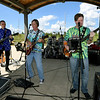 "Members of the Neosho-based band, ""The Grays"" entertain the crowd during the Joplin Arts Fest on Saturday at Mercy Park.<br /> Globe 