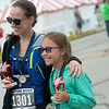 Megan Petty and her daughter Evelyn, 9, Centerton, Ark., show off their trophies after placing in their age groups in the 5K race of the Mother Road Marathon on Sunday in Joplin.<br /> Globe | Roger Nomer