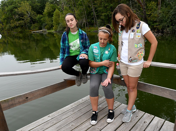 From the left: Girl Scouts Shayla Gould, 12, Emily Graves, 11 and Alyssa Graves, 13 talk about what Camp Mintahama means to them on Wednesday at the camp.<br /> Globe | Laurie Sisk