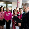 Joplin Mayor Gary Shaw reads a proclaimation declaring October Breast Cancer Awareness month during the Pink Ribbon Bagel kickoff on Sept. 27 at Panera.<br /> Globe | Roger Nomer