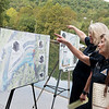 Sara Parker Pauley, director of the Missouri Department of Conservation, left, and Marilynn Bradford, commissioner of the MDC, talk about plans for the expansion of the Roaring River hatchery on Friday.<br /> Globe | Roger Nomer