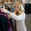 Katy Johnson, development assistant at Lafayette House, prepares a display for Domestic Violence Awareness Month at Second Chances thrift shop on Wednesday.<br /> Globe   Roger Nomer