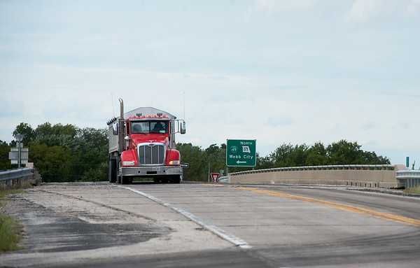 A truck crosses on the Highway 96 bridge over Highway 171 near Carthage on Tuesday.<br /> Globe | Roger Nomer