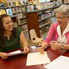 Pat Wakefield, bilingual educator, talks with Aleyda Hernandez-Ochoa during a citizenship class on Tuesday at the Carthage Public Library.<br /> Globe | Roger Nomer