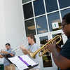 (from left) Jonathan Gonzalez, a Missouri Southern junior from Joplin, Trevor Turner, a freshman from Joplin, and Jemetris Brown, a senior from Orlando, Fla., practice outside Taylor Performing Arts Center on Tuesday. The trumpet studio students practice outside to enjoy the day and because rehearsal space inside was limited.<br /> Globe | Roger Nomer