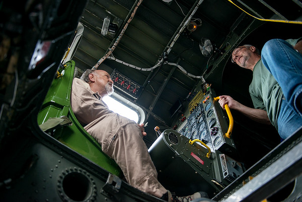 Mike Swanson, aircraft scanner, gives a tour of the B-29 cockpit to Mark Duncan, Carthage, on Monday at the Joplin Regional Airport.<br /> Globe | Roger Nomer