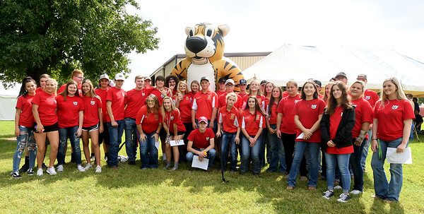 A large contingent of Carl Junction FFA students take taime out for a photograph on Thursday at the University of Missouri Southwest Research Center near Mount Vernon. <br /> Globe | Laurie SIsk