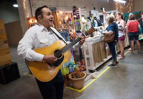 Sonny Lau, Joplin, performs at the Empire Market on Saturday morning.<br /> Globe | Roger Nomer