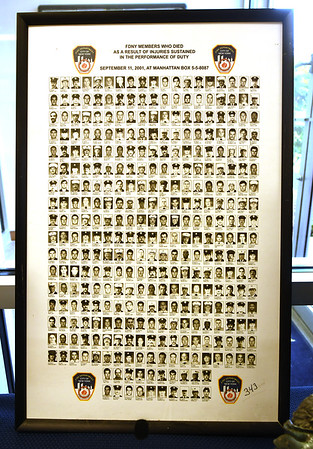 A large poster memorializes FDNY firefighters who lost their lives responding to the Sept. 11, 2001 attacks on the World Trade Center. <br /> Globe | Laurie Sisk