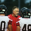 Lamar head coach Scott Bailey talks with his players before Friday's game against Seneca.<br /> Globe | Roger Nomer