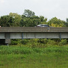 Cars travel on the 249 Highway bridge over Turkey Creek on Wednesday.<br /> Globe | Roger Nomer