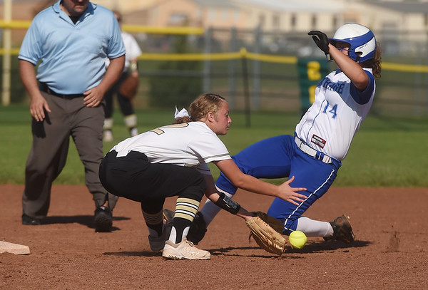 Carthage's Sydney Peters slides safely past Neosho's Sierra Jones during Saturday's Paige Neal/Christina Freeman Softball Tournament at the Joplin Athletic Complex.<br /> Globe | Roger Nomer