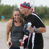 Rachelle Fuentes, Springdale, Ark., greets her father John McDaniel, Derby, Kan. as he finishes the half-marathon race of the Mother Road Marathon on Sunday in Joplin.<br /> Globe | Roger Nomer