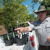Chad Hays, maintenance, talks about various trees that will planted during Saturday's event during an interview at Carver National Monument on Wednesday.<br /> Globe | Roger Nomer