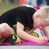 Colton Duvall, 9, Miami, works on a sign of support for family members running in the Mother Road Marathon on Sunday in Joplin.<br /> Globe | Roger Nomer