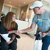 Dave Fischer meets with Sandra Benson, Joplin, at the Mercy Cancer Center on Tuesday afternoon. Fischer is part of a team called Powered by Hope, that is cycling from Oklahoma City to St. Louis. The team is stopping at cancer centers along the way handing out medallions of encouragement to those going through cancer treatments.<br /> Globe | Roger Nomer