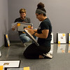 Patrick Laird, a Missouri Southern senior from Perry, Kan., and Shay Thomas, a senior from El Dorado Springs, set up a gallery of photos by Edvard Munch at the Spiva Gallery at MSSU on Wednesday.<br /> Globe | Roger Nomer