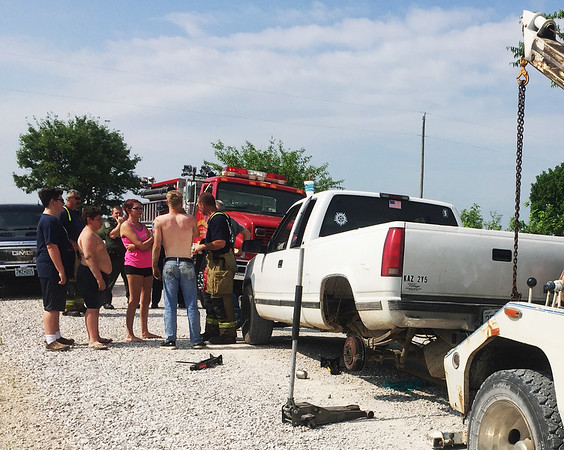 This photo from the scene shows the truck that fell on the trapped person as well as Ron Riediger's tow truck on the right.<br /> Photo Courtesy Ron Riediger