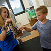 Katlin Dunsing, a Pittsburg State senior from Lamar, holds a ball python for Charlie Anderson, 7, at PSU's Nature Reach on Tuesday.<br /> Globe | Roger Nomer