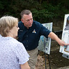 Jack Quade, with Jefferson City Design and Development, right, shows plans for the pool renovation to Rick and Jeanne Thompson, Carthage, at Roaring River State Park on Friday.<br /> Globe | Roger Nomer