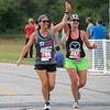 Paulette Spriggs, left, and Jill Wedig, Lake Ozark, Mo., celebrate completing the half-marathon during Sunday's Mother Road Marathon in Joplin.<br /> Globe | Roger Nomer