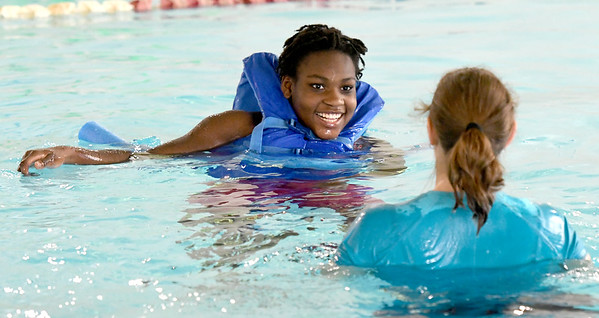 From the left: Triathlete Vanessa Workman smiles as she works with personal assistant Angela Covington on Friday at the Neosho Freeman Family YMCA. Workman is training to compete Sunday in St. Louis at the Tri My Best Adaptive Triathlon.<br /> Globe   Laurie SIsk