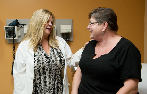 Tina Reeves, women's health care nurse practioner, talks with Theresa Martin, Carthage, on Wednesday at Access Family Medical.<br /> Globe | Roger Nomer