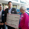 Hope 4 You Breast Cancer Foundation presents a check to the Freeman Health Foundation for mammograms during the Pink Ribbon Bagel kickoff at Panera on Sept. 27.<br /> Globe | Roger Nomer